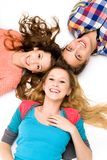 Three young people lying down. Three young people over white background Stock Photos