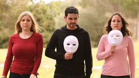 Three young people with mask stock video footage