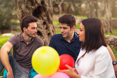 Three young people on picnic  under the olive trees Stock Photo