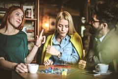 Funny play. Three friends at cafe. royalty free stock photos