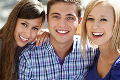 Three young people smiling. Portrait of young people outdoors Stock Images