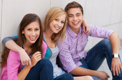 Three young people smiling. Portrait of young people smiling Royalty Free Stock Photos