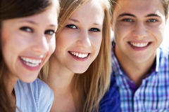 Three young people smiling stock photography