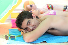 Three young people sunbathing. At the beach Stock Images