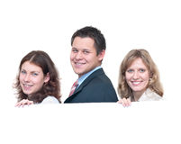Three young people a team. Three young people a businessmen holding placard. Isolated on white background Stock Images