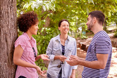 Three young people in wooded area Stock Photography