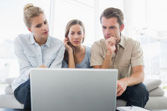 Three young people working on computer Royalty Free Stock Images