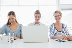 Three young people working in office Stock Images