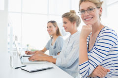 Three young people working in office Stock Photo