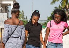 Three young and pretty Jamaican women Stock Image