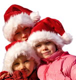 Three young Santa Clauses.  Royalty Free Stock Image