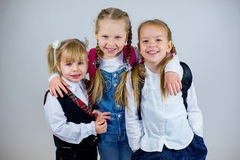 Three young schoolgirls stock photos