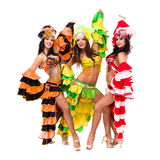 Three young sexy carnival dancers posing. Against isolated white background Royalty Free Stock Photo