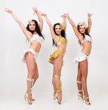 Three young sexy women dancing Royalty Free Stock Images