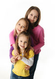 Three young sisters having fun Stock Photos