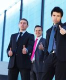 Three young and smart business persons Royalty Free Stock Image