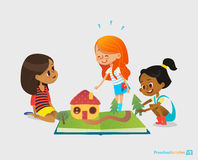 Three young smiling girls sit on floor, talk and play with pop-up book. Children`s entertainment and preschool royalty free illustration