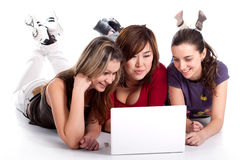 Three young student with laptop Royalty Free Stock Photography