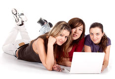 Three young student with laptop Stock Photos