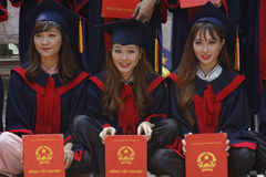 Three young students with their diploma Royalty Free Stock Images