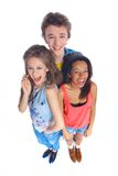 Three young teenagers. Laughing. Isolated on white background royalty free stock images