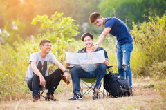 Three young tourist discuss the trip Royalty Free Stock Photos