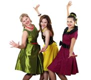 Three young woman in bright colour dresses Royalty Free Stock Image