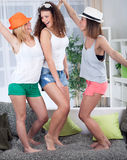 Three young woman dancing at home Stock Image