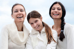 Three young woman enjoying autumn Royalty Free Stock Photos