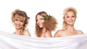 Three young woman with flower hair style Stock Photos