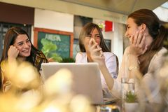Three young woman having fun, talking at coffee break. Three young women having fun, talking at coffee break. Smiling happy woman Royalty Free Stock Images