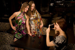 Three young woman in the nightclub Royalty Free Stock Photos