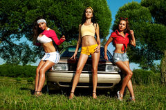 Three young woman pin-up style near retro car Royalty Free Stock Photo