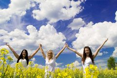 Three young woman in rape field Royalty Free Stock Photography