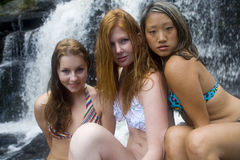 Three young woman at waterfall Royalty Free Stock Photo