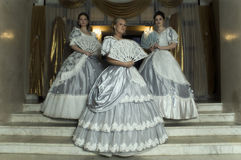 Three young women in ball gowns Royalty Free Stock Photos