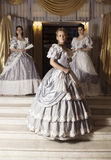 Three young women in ball gowns Royalty Free Stock Photo