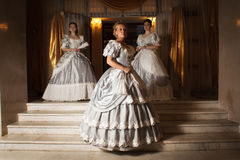 Three young women in ball gowns Royalty Free Stock Images