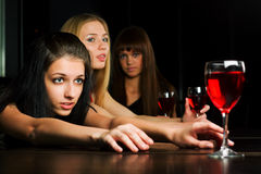Three young women in a bar. Stock Photo