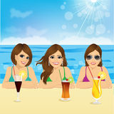 Three young women on the beach. Group of three young women on the beach with positive smiling face expression Stock Images