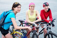 Three  young women on bicycle Royalty Free Stock Photography