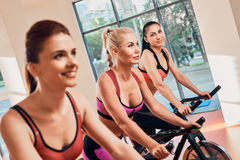 Three Young women on bikes Stock Images