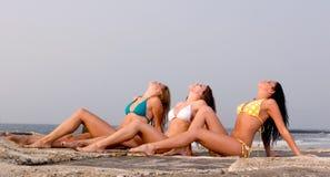 Three Young Women in a Bikini. Three Beautiful Young Women in a Bikini on the beach Royalty Free Stock Image