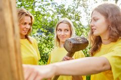 Three young women are building with tools royalty free stock images