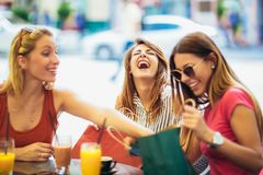 Young women in a cafe after a shopping royalty free stock images