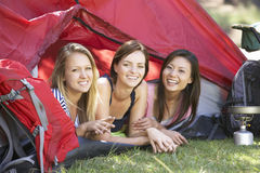 Three Young Women On Camping Holiday Together Stock Photography