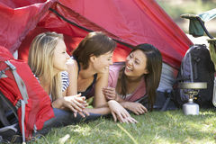 Three Young Women On Camping Holiday Together Royalty Free Stock Photos