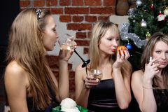 Three young women celebrated christmas Stock Photo
