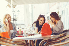 Three young women at coffee Royalty Free Stock Photos