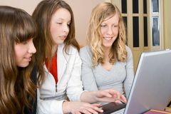 Three Young Women With Compute Royalty Free Stock Images